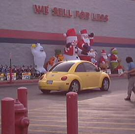 Blow up santas and christmas characters in front of Walmart