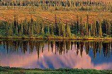 Mountain Range in Alaska, longer lens zooms in on water reflection - photograph by Brent VanFossen