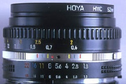 View of the top of a lens featuring a depth of field scale, photograph by Brent VanFossen