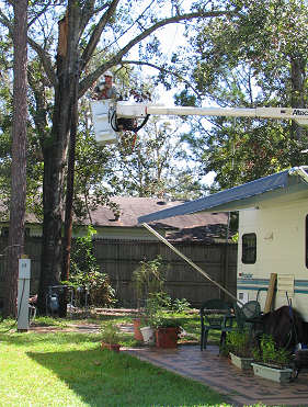 Alabama Power repairing power cables from snorkel over our trailer, photograph by Lorelle VanFossen