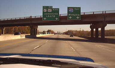 Highway signs pointing to Memphis or Jackson, photo by Lorelle VanFossen