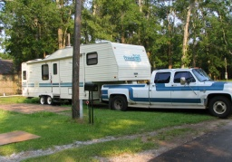 Trailer packed up and pulling out of Shady Acres Campground in Mobile, Alabama, ahead of Hurricane Dennis, photograph by Lorelle VanFossen