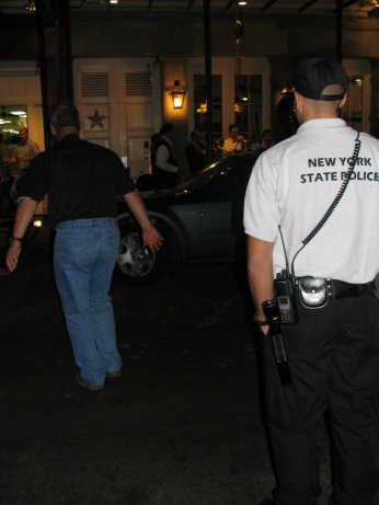 NY Cops and friends dance in the streets near Bourbon Street to a local band, photograph by Lorelle VanFossen