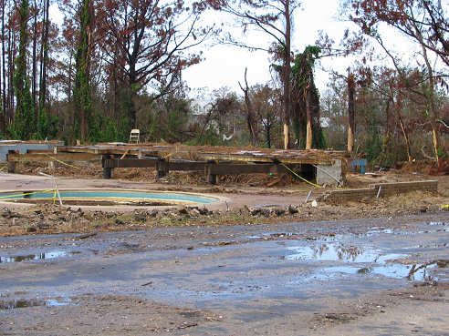 Remains of swimming pool in destroyed home