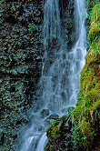 Waterfall with the water photographed at a high shutter speed, photograph by Brent VanFossen