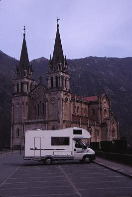 Rented motorhome in front of Covadunga Cathedral, northern Spain, photograph by Lorelle VanFossen