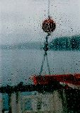 Looking through a ferry boat window covered with rain, photograph by Lorelle VanFossen
