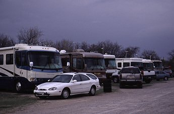 row of parked motor homes, photograph by Brent VanFossen