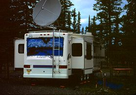Huge fifth wheel trailer in Alaska hosts a giant satellite dish, photograph by Lorelle VanFossen