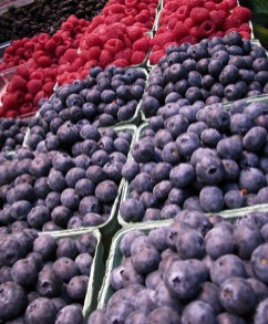 granville island berries in market by lorelle vanfossen
