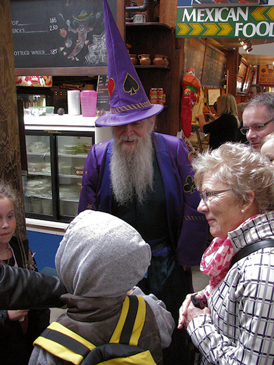 granville island market wizzard magician performs by lorelle vanfossen