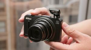 Nikon CoolPix S9700 Manual - camera front side