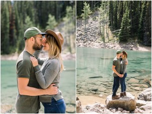 Adventuring couple posing for engagement session at Mirror Lake in Banff National Park