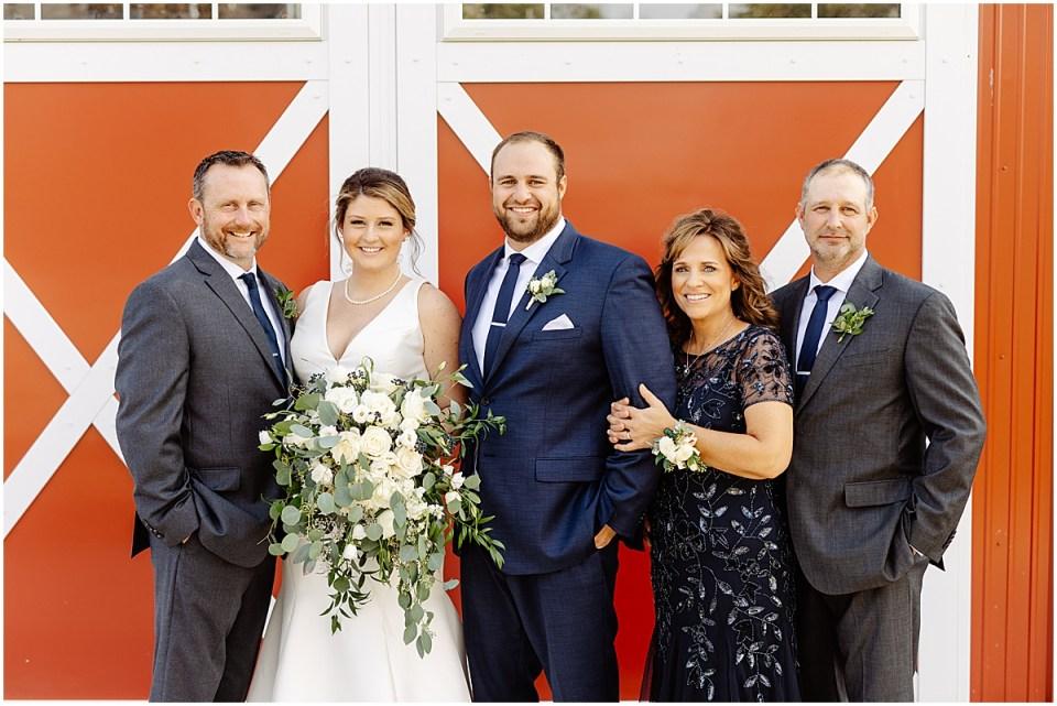 family photo at red farm barn