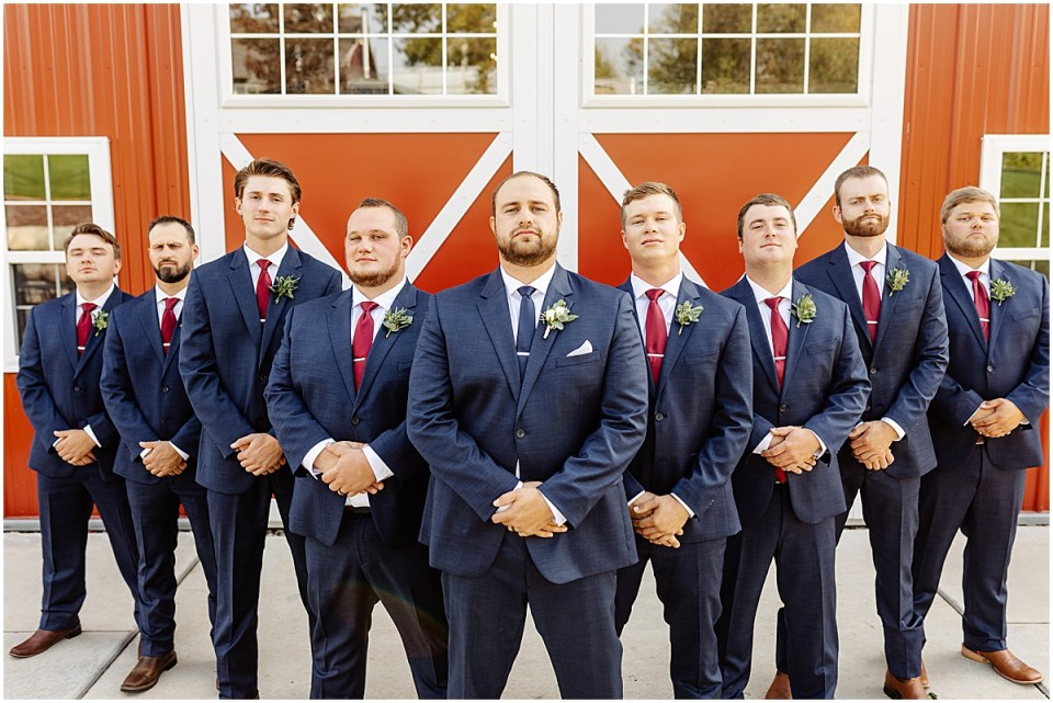serious groomsmen picture at red barn farm