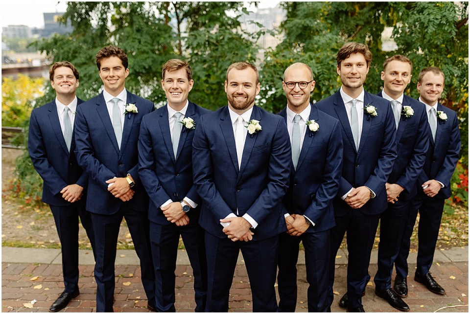 Groomsmen classic pose formation at wedding