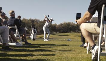Cameron Champ on driving range at 2019 fundraiser outing