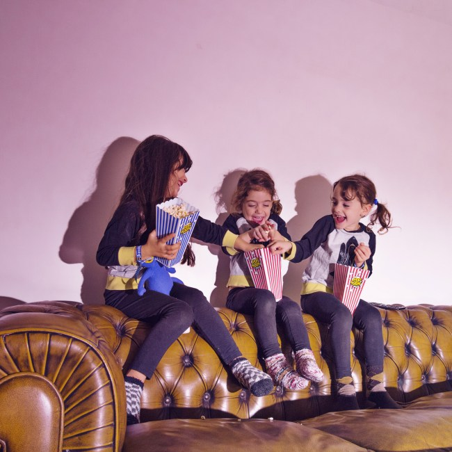 playing-little-girls-with-popcorn-couch