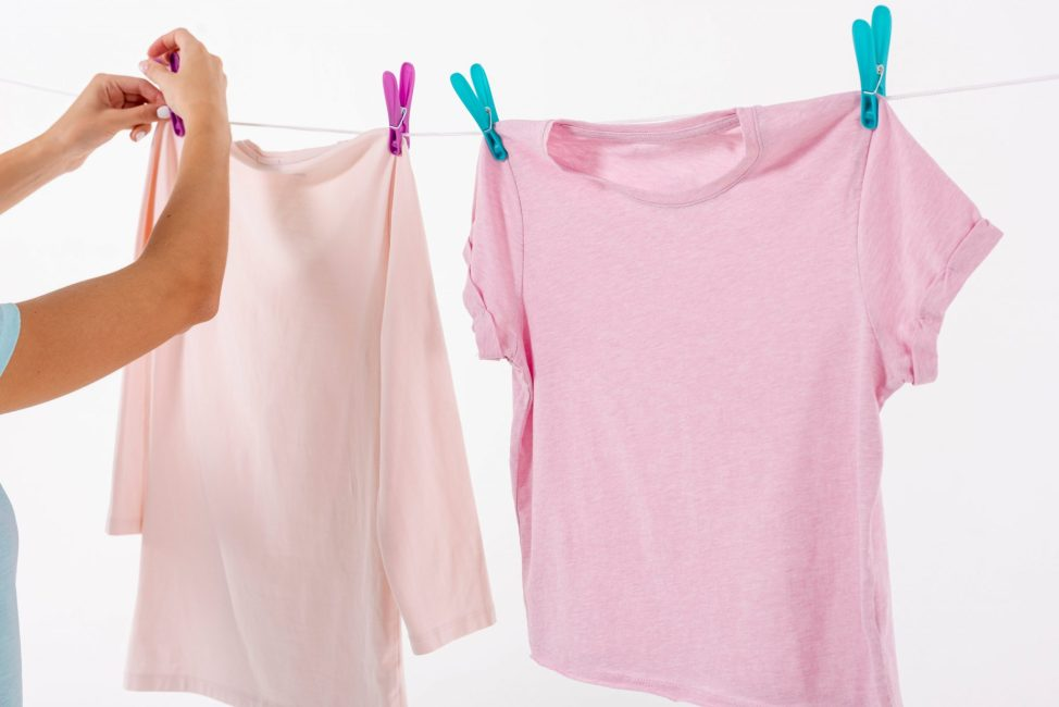 woman-fixing-t-shirts-on-clothesline-with-clothes-pins