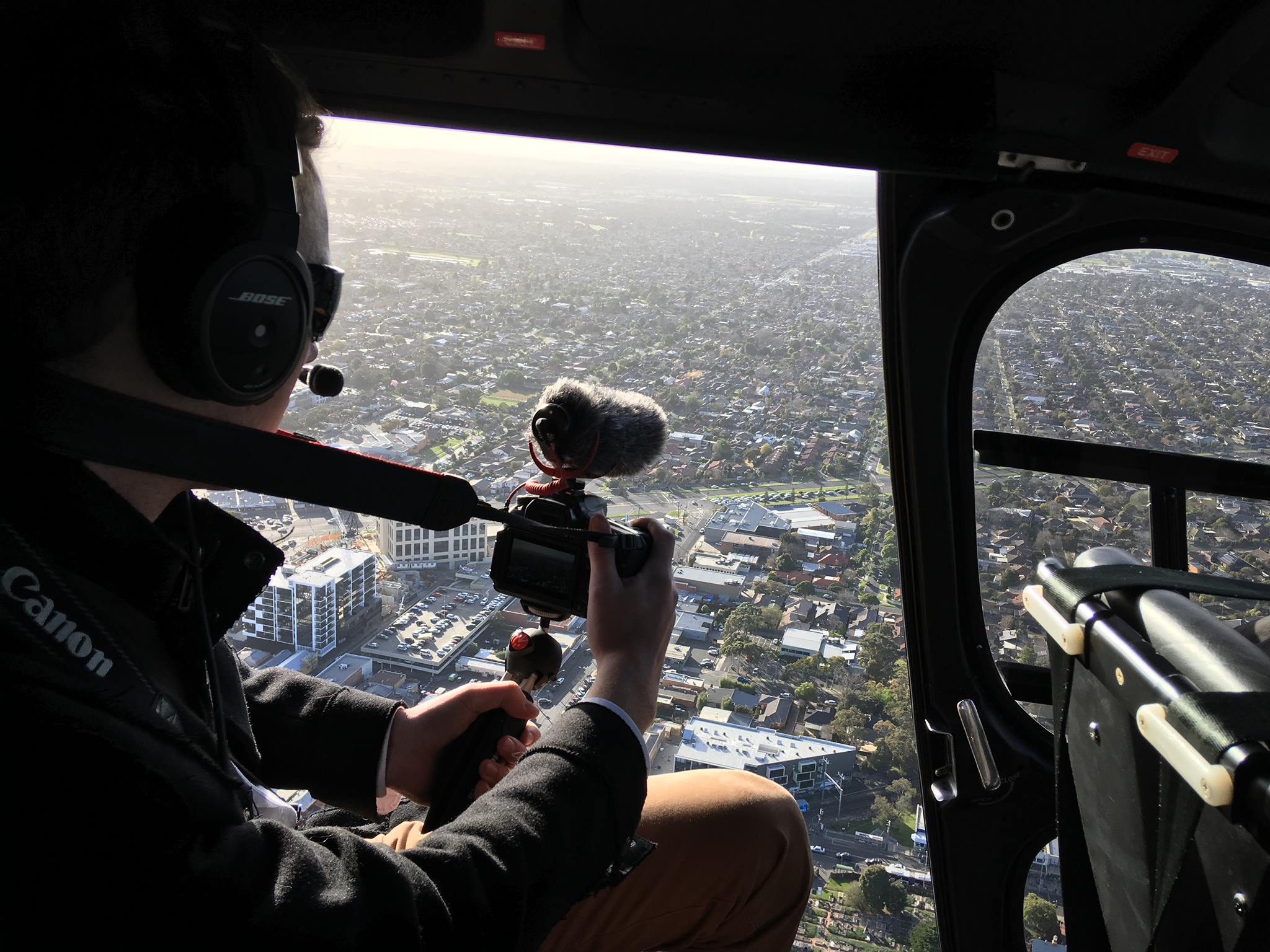 Cameron Howe up in the air with The Mordialloc Chronicle and RACV