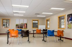Interior view ofWhispering Prairie Program Center equipped with chairs and tables.