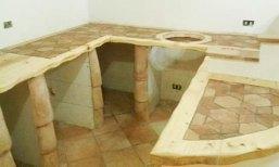 Cucina in cotto e legno di F. Nolfo