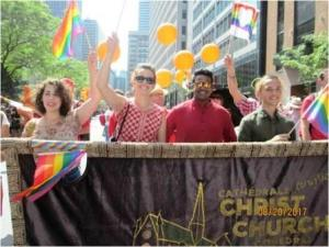 Christ Church Cathedral social justice activists carry banner at gay pride parade in Montreal