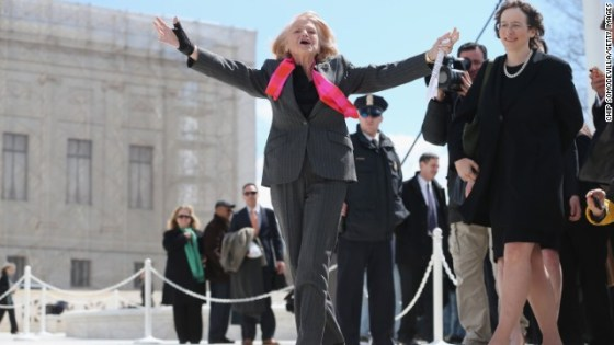 Edie acknowledging her supporters outside the Supreme Court