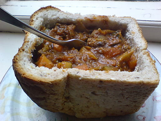 A bunny chow - originally not served on a plate with a fork