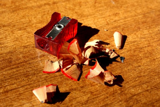 red-pencil-sharpener-with-pencil-shavings