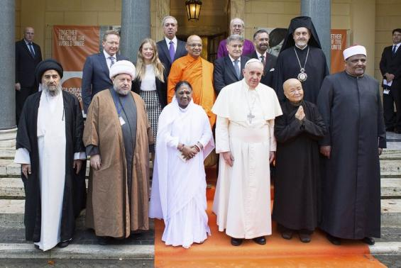 Pope Francis poses with religious leaders during a meeting at the Pontifical Academy of Sciences at the Vatican