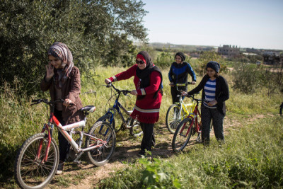 Palestinian women cycling