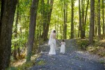 Poconos Flower girl and bride walking in woods