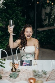 Cheers! Bride toasts at non traditional wedding in Oregon