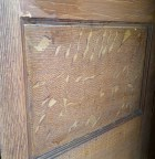 More detail of the cabinet's original wood grain.