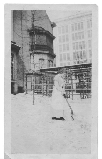Campbell House servant shoveling snow in the garden ca. 1920. By this point the Campbell sons had added the awning seen at top left to the master bedroom balcony.