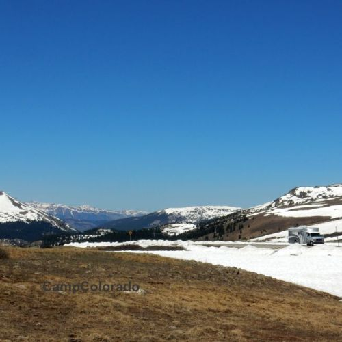 An RV motorhome driving along Independence Pass in mid-June. Photo taken by Camp Colorado.