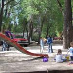 Playground under the trees at Chalk Creek RV Park & Campground near Buena Vista Colorado