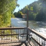Lovely, spacious deck for riverside relaxation ~ Outpost Motel, Cabins & RV Park