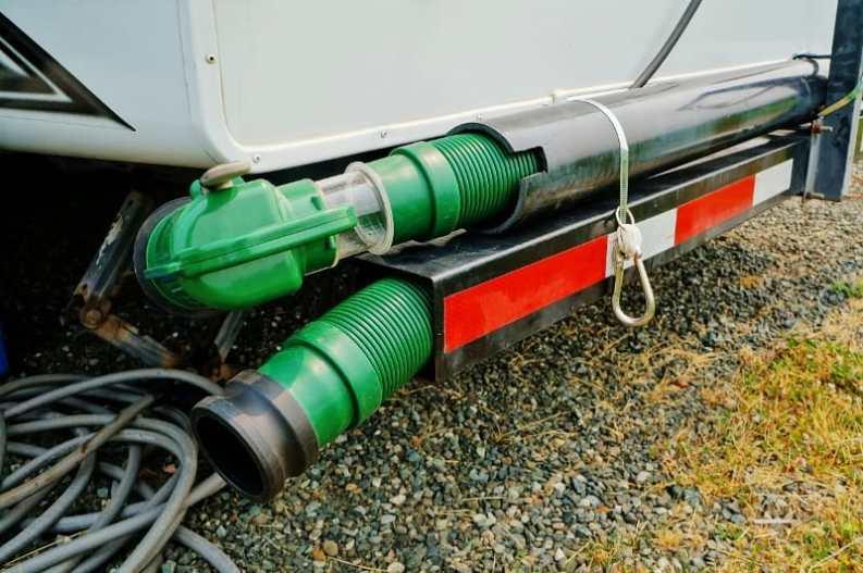 RV Sewage Hose Storage Green