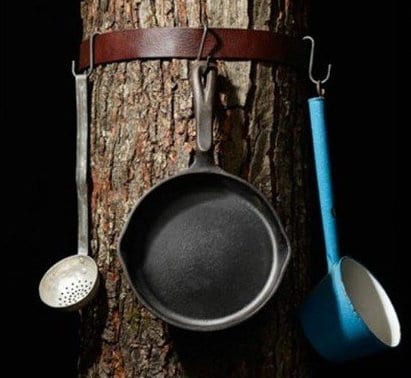 Hang pots and utensils from a belt fastened around a tree