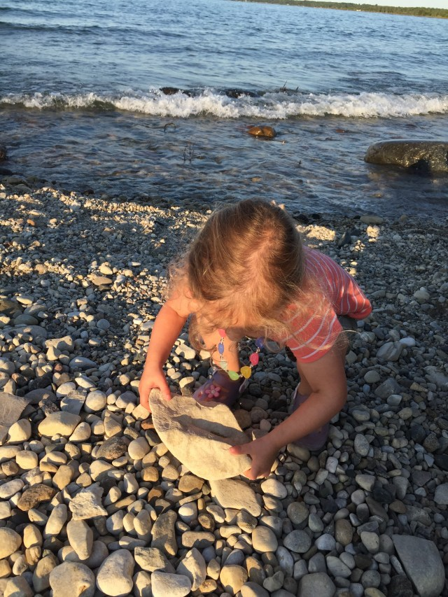 She did manage to lift this rock, but made daddy throw it into the water!