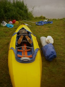 Loading tent into kayak.