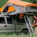 Antony Michael of Camping Challenge next to a rooftop tent