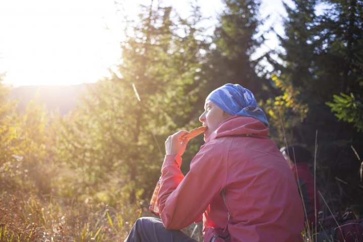 Woman hiker enjoying snack food