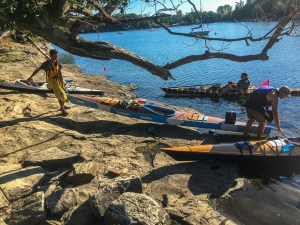 Image of explorers putting their kayaks into the water for another day of kayaking!