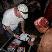Roy Ayers Signing a T-Shirt