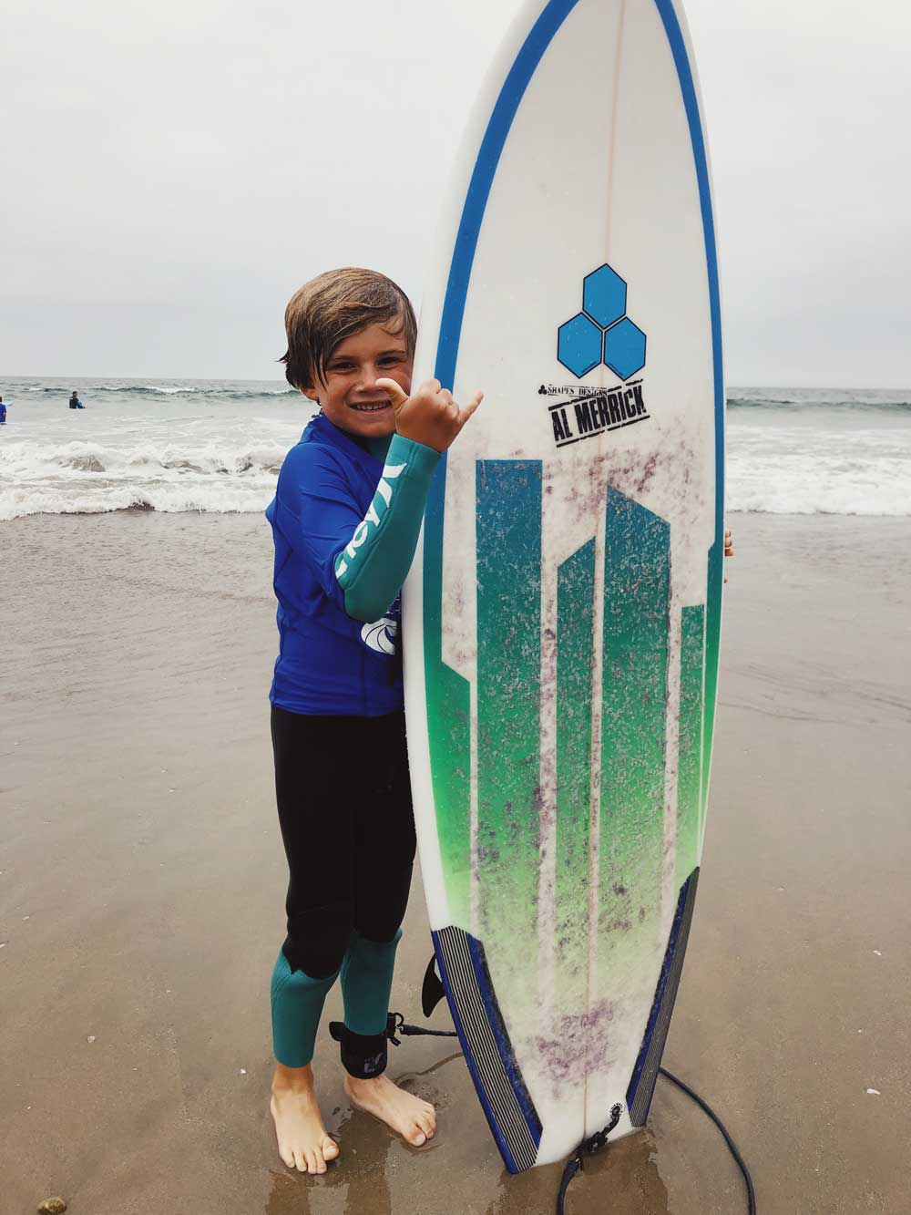 Grom with surfboard