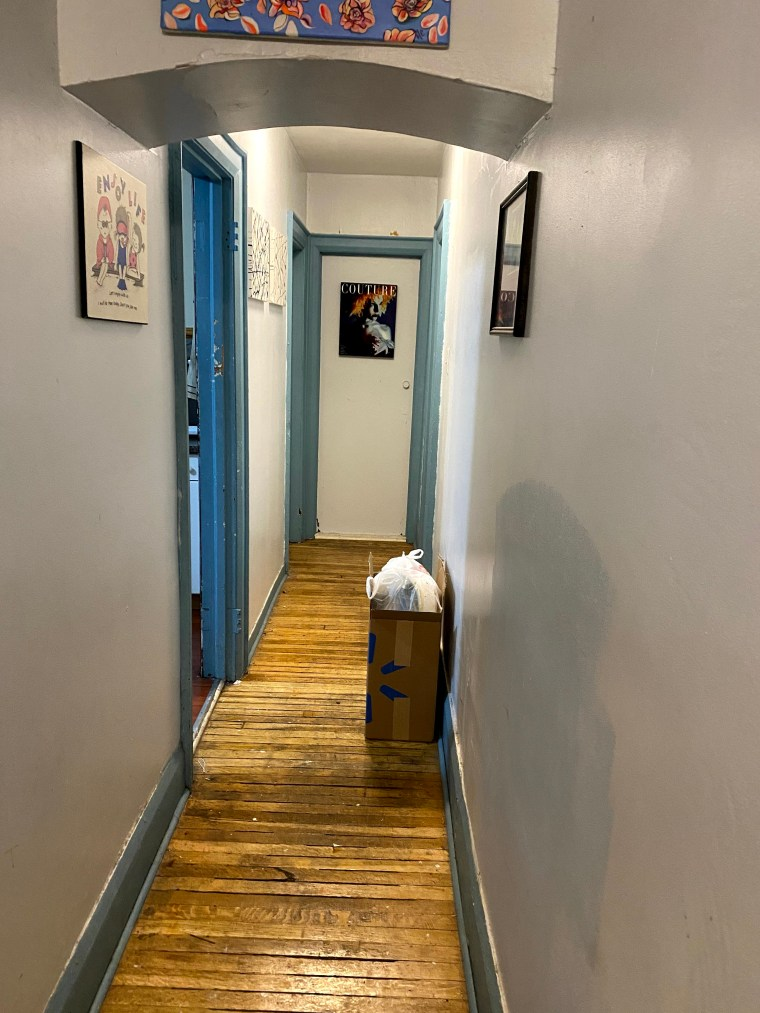 A hallway with two pieces of art