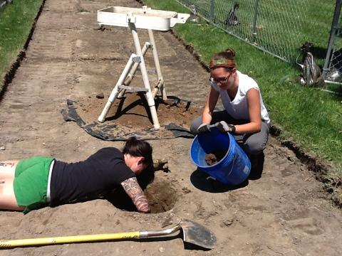 Excavating a shovel test pit